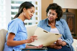 elderly woman talking with a social worker
